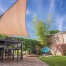 Modern backyard with shade sail.