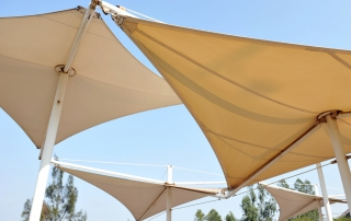 Shade sails protecting an outdoor space from the sun