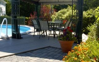 Gazebo In A Sunny Backyard With Swimming Pool